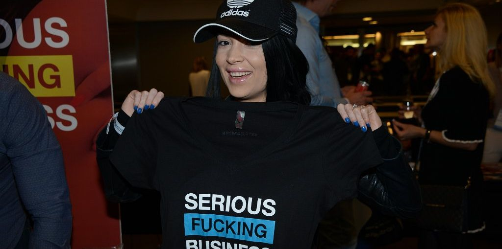 "Picture of TES 2017 Attendee Holding up ""Serious Fucking Business"" T-Shirt."