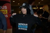 """Picture of TES 2017 Attendee Holding up """"Serious Fucking Business"""" T-Shirt."""