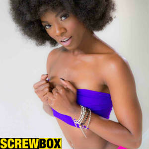 Promo photo of Ana Foxxx sporting an afro and skimpy tube top.nd