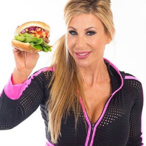Puma Swede in a studio promo shot posing wih one of her hamburgers.