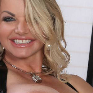 Close up photo of Vicky Vette smiling.