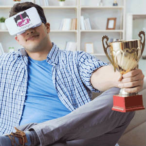 Humourous photo of a man with VR Bangers goggles holding a golden trophy cup.