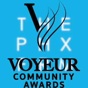 The VOYEUR Community Awards logotype over a large slightly blurry Phoenix Forum logo.