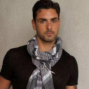Publicity shot of Ryan Driller being sexy in a kashmir scarf.