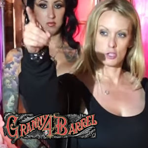 On-set photo of Stormy Daniels pointing, directing a new rock video.