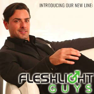 Publicity photo of Driller reclining on divan with the Fleshlight Guys logo superimposed.