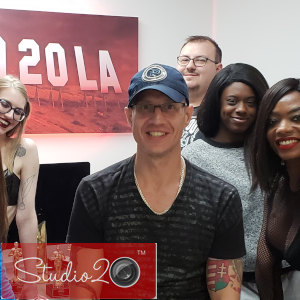 Photo of Douglas Richter surrounded by some of his Los Angeles co-workers in a group shot with Studio20 watermark.