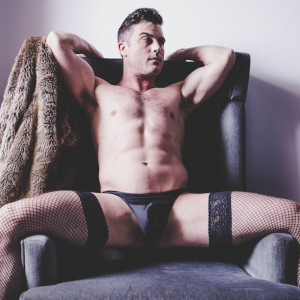 Lance Hart all sexy in garter hose and a mini pair of briefs. And nothing else.