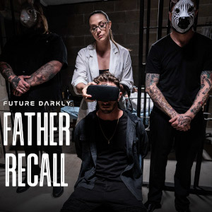 A creepy still from Father Recall, with two animal-masked, tattooed brutes at either side of a possibly sexy scientist lady putting a headset over the eyes of a man bound to a chair before her...