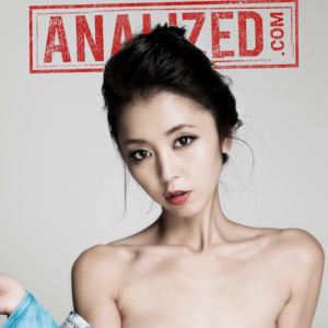 Marica Hase in a promo photo of her thin and pale naked shoulders against a pale background, the Analized.com logo behind her.