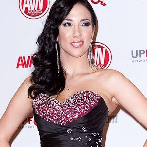 Jelena Jensen posing in sequined evening gown at the ANV Awards red carpet.