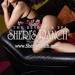 A boudoir photo of a woman in lingerie on a divan, with the Sheri's Ranch logo superimposed.