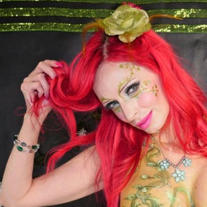 A photo of fire-engine red-haired Shanda Fay with apparent fancy body painting (most of which is out of view).