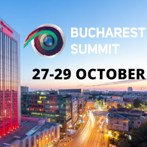 Promotional image of the Bucharest Sheraton overlooking a busy street with the Summit logo above.