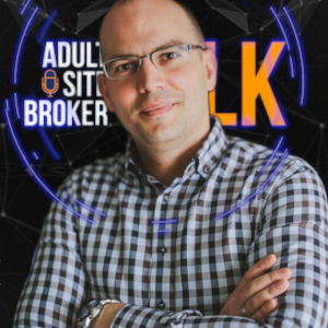 A photo of Quantox Technology Filip Karaicic over a mashup of the ASBTalk logo and Quantox background.