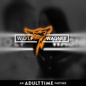 A soft-focus black and white photo background with the Wolf Wagner logo superimposed.